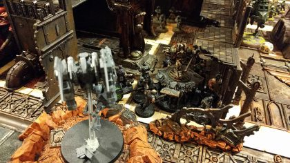 The Tau watch on as Typhus reaps some guard.